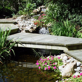 Inspiration for a mid-sized timeless backyard dock remodel in Other with no cover