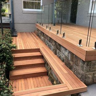 Ispirazione per terrazze e balconi minimalisti nel cortile laterale con un pontile e nessuna copertura