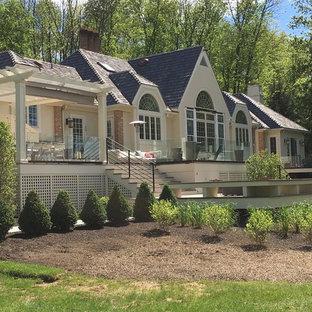 Design ideas for an expansive contemporary backyard deck in Philadelphia with a pergola.