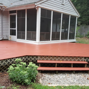 This is an example of a medium sized rustic back terrace in Boston with no cover.