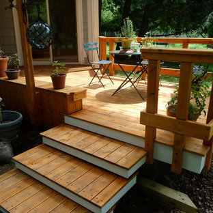 Large backyard deck photo in New York with no cover