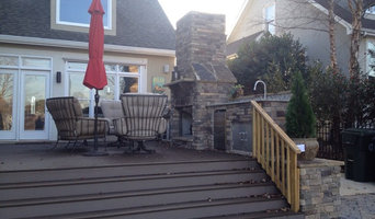 Deck with outdoor kitchen and fireplace