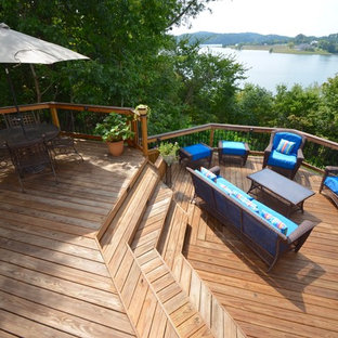 Deck - large tropical backyard deck idea in Other