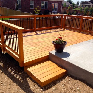Mid-sized traditional backyard deck in Denver with no cover.