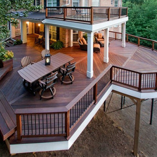 Deck container garden - large craftsman backyard deck container garden idea in Atlanta with a roof extension