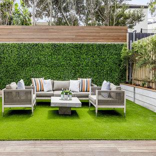 Idee per una terrazza design dietro casa con nessuna copertura