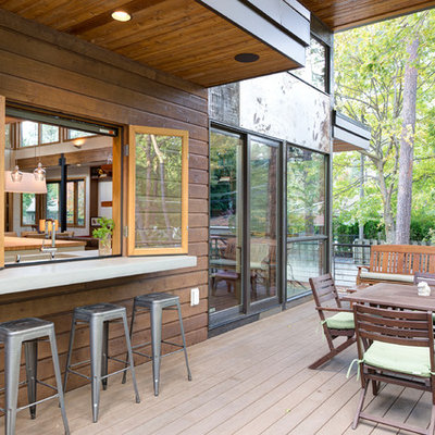 Example of a mid-sized minimalist backyard outdoor kitchen deck design in Seattle with no cover