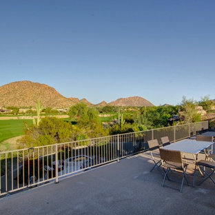 Inspiration for a huge southwestern rooftop deck remodel in Phoenix with no cover
