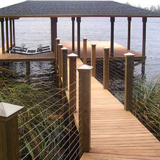 This is an example of a mid-sized transitional backyard deck in Orlando with with dock.