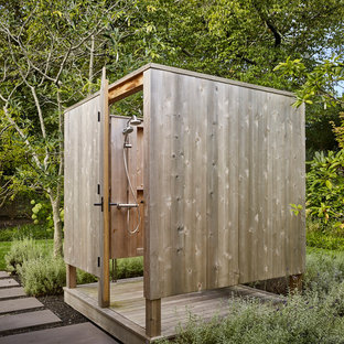 Example of a beach style outdoor shower deck design in New York with no cover