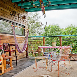 Inspiration for an eclectic deck remodel in Austin with a roof extension
