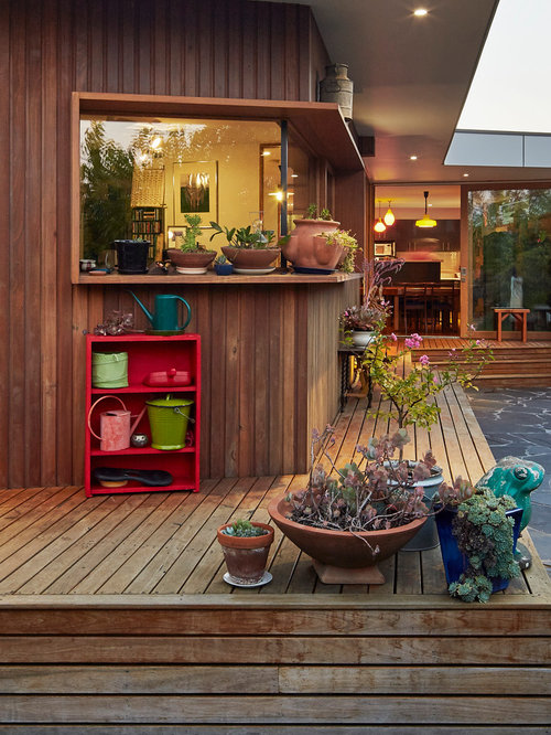 Inspiration For A Mid Sized Country Backyard Deck In Melbourne With A  Container Garden And