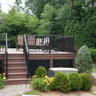 Example of a large classic backyard deck skirting design in New York with no cover