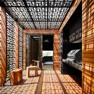 Idee per una terrazza minimal dietro casa e di medie dimensioni con una pergola