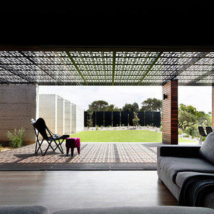 Design ideas for a mid-sized contemporary side yard deck in Melbourne with a pergola.