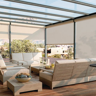 Large transitional rooftop outdoor kitchen deck photo in Other