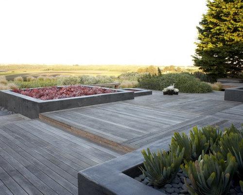 asiatische terrasse mit k belpflanzen ideen design bilder houzz. Black Bedroom Furniture Sets. Home Design Ideas