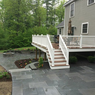 Mid-sized elegant backyard deck photo in Boston with a fire pit