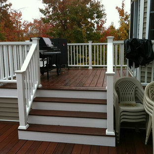 Inspiration for a mid-sized timeless backyard deck remodel in Boston with a fire pit and no cover