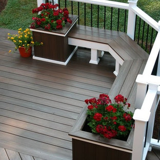 Large arts and crafts backyard deck container garden photo in Charlotte