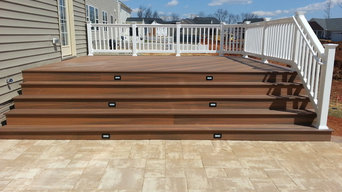 Fiberon deck with steps down to custom paver patio in Point of Rocks, MD