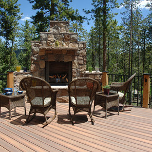 Example of a mountain style deck design in Charlotte with a fire pit