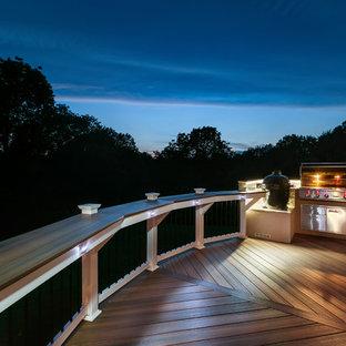 Outdoor kitchen deck - mid-sized transitional outdoor kitchen deck idea in Charlotte