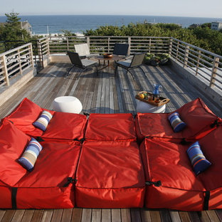 This is an example of a beach style rooftop deck in New York.