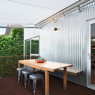 Mid-sized urban backyard deck photo in Seattle with an awning