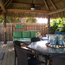 Tropical Deck by Pamela DeCuir Interior Designs