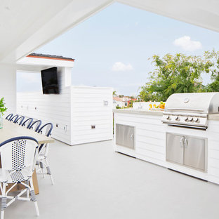 Design ideas for a large farmhouse roof terrace and balcony in Orange County with an outdoor kitchen and a roof extension.