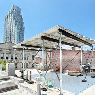 Foto di una terrazza industriale di medie dimensioni e sul tetto con una pergola