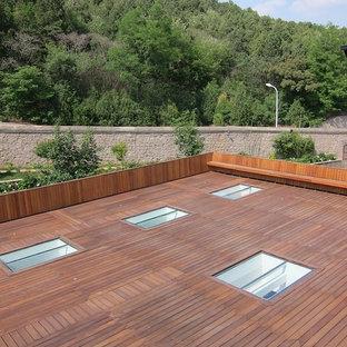Idee per un'ampia terrazza etnica sul tetto