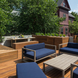 Inspiration for a contemporary rooftop deck container garden remodel in Boston