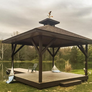 Inspiration for a french country backyard dock remodel in Cleveland with a roof extension