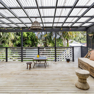 This is an example of a large mediterranean rooftop deck in Sydney with an awning.