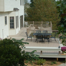Traditional Deck by Design Builders, Inc.