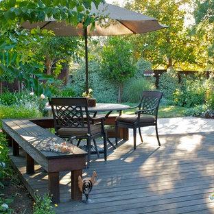 Ispirazione per una piccola terrazza chic dietro casa con nessuna copertura