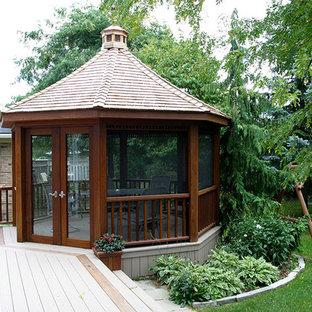 Diseño de terraza actual, grande, en patio trasero