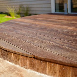 Small farmhouse courtyard deck photo in Christchurch with no cover
