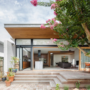 Design ideas for a mid-sized contemporary backyard deck in Sydney with a roof extension.