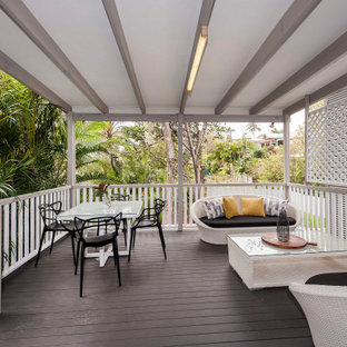 Transitional deck in Brisbane with a pergola.