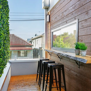 This is an example of a scandinavian deck in Melbourne with no cover.