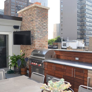 Inspiration for a large contemporary rooftop outdoor kitchen deck remodel in Chicago with a pergola
