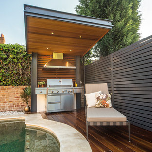 Photo of a contemporary deck in Sydney with an outdoor kitchen.