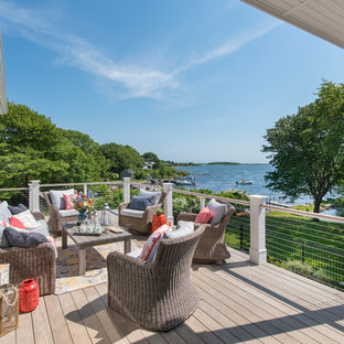 Inspiration for a mid-sized coastal backyard water fountain deck remodel in Providence with no cover