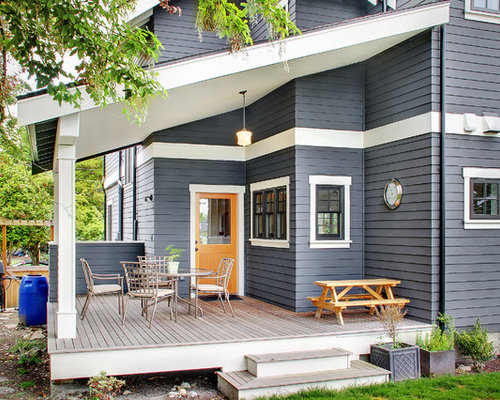 midsized elegant backyard deck photo in seattle with a container garden and a roof - Exterior House Paint Colors