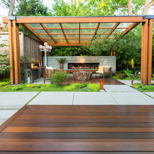 Inspiration for a mid-sized contemporary backyard deck remodel in Seattle with a fireplace