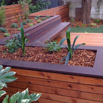 Hardwood deck with built-in bench and planters