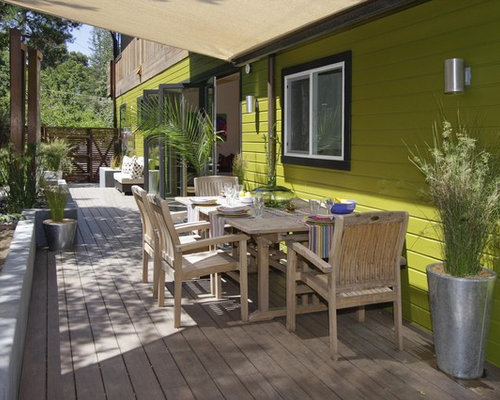 trendy deck photo in san francisco with an awning - Deckideen Nz